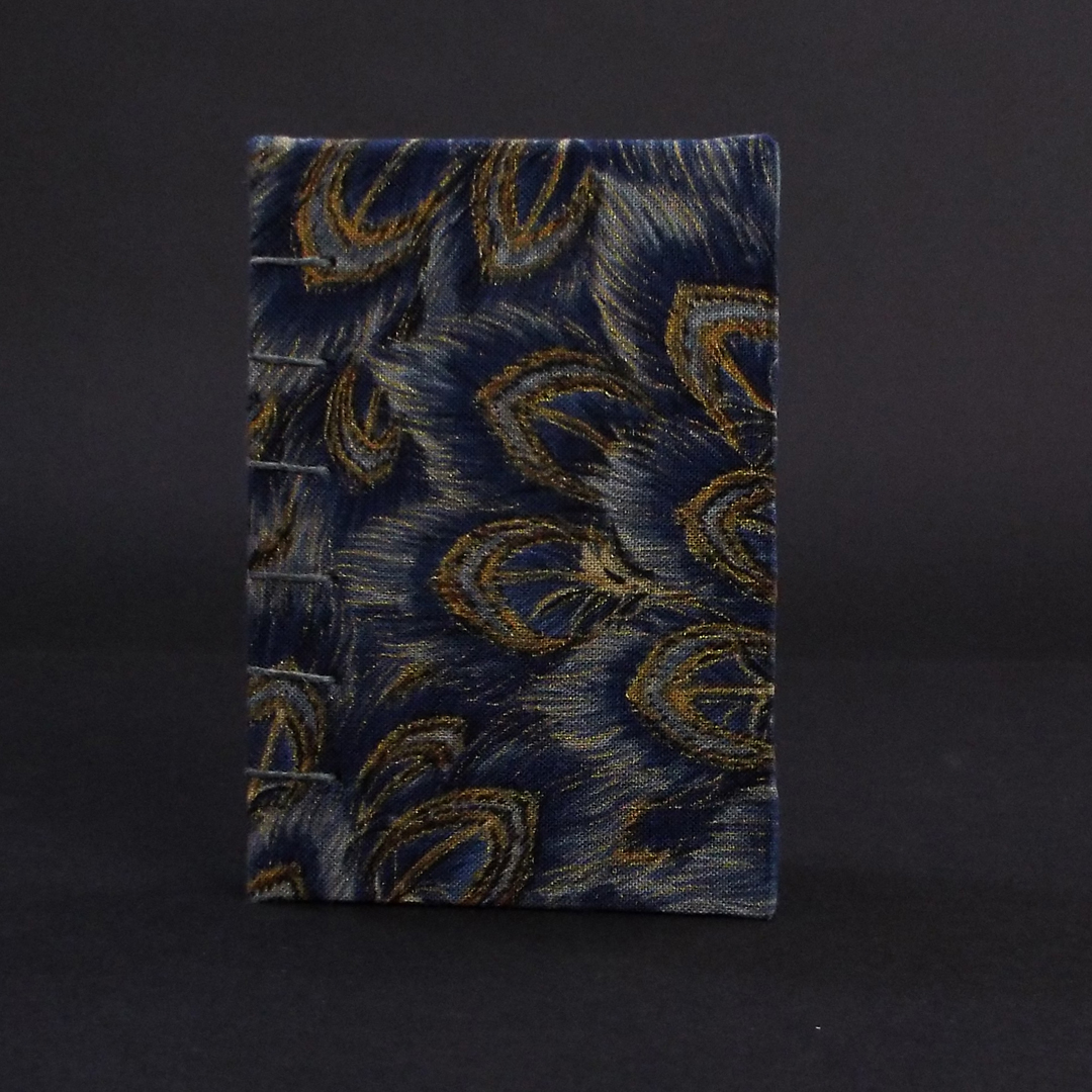 Blue peacock mini coptic bound book cover featuring blue and gold peacock feather