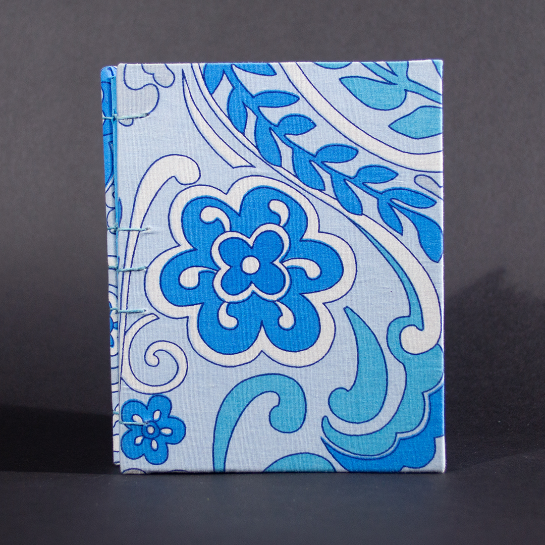 The front cover of blue floral octavo Coptic bound journal