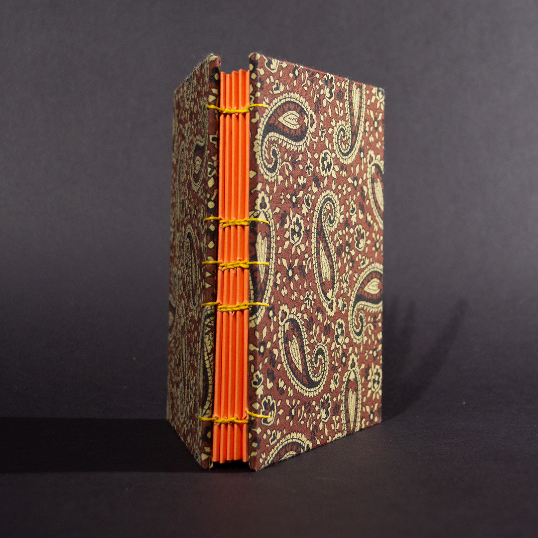 Brown paisley octavo Coptic bound journal spine view