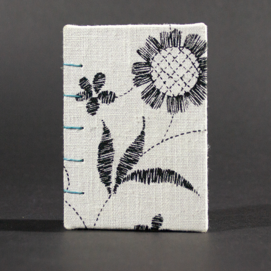Front cover of lack and white floral mini Coptic book