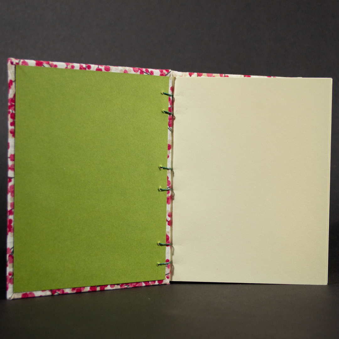 Insides of cherry blossoms octavo octavo book with cotton ivory pages and green end pages
