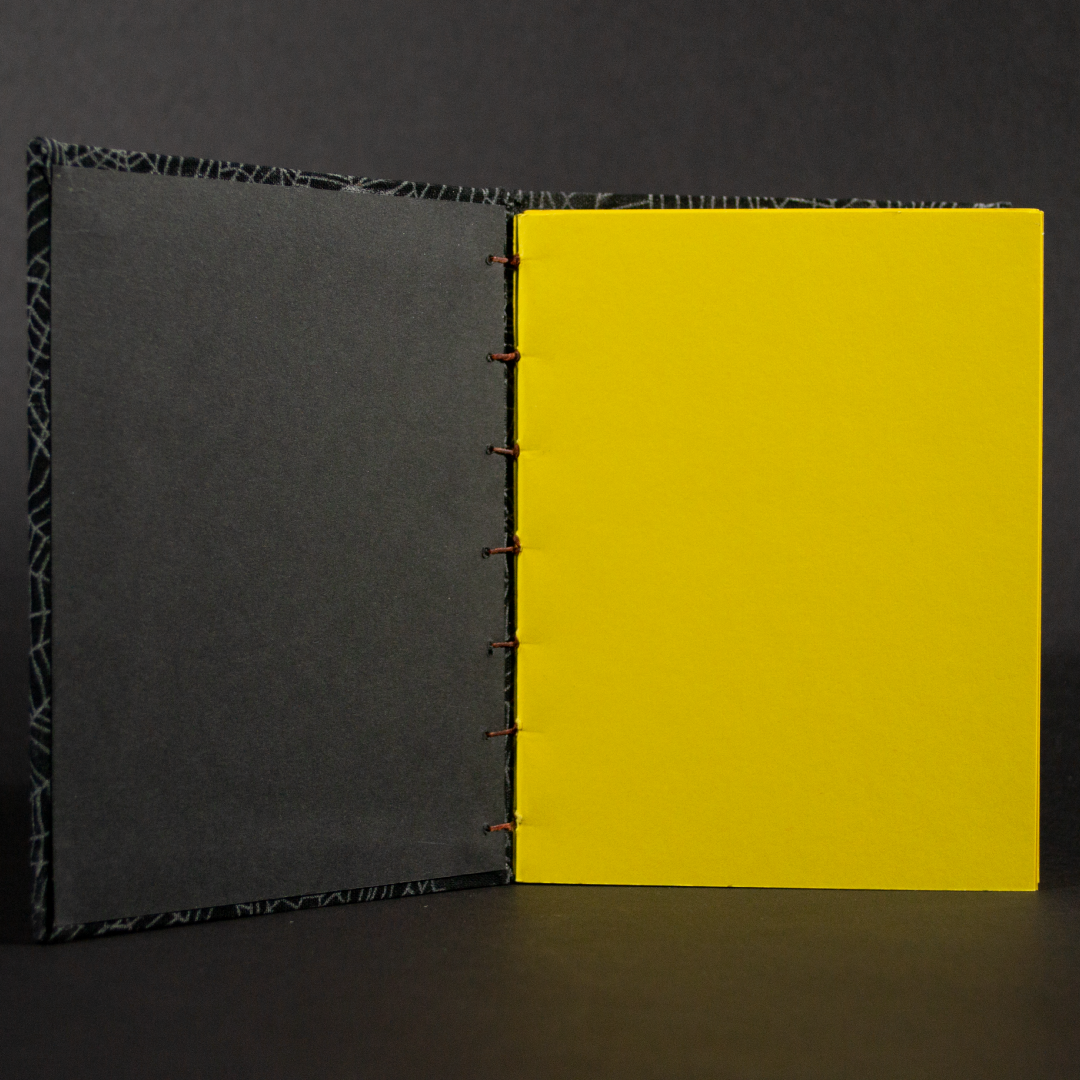 Insides of cobwebs octavo Coptic book with yellow cardstock pages and black end pages