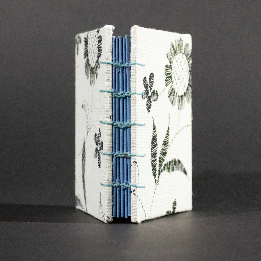 Spine view of black and white floral mini Coptic book