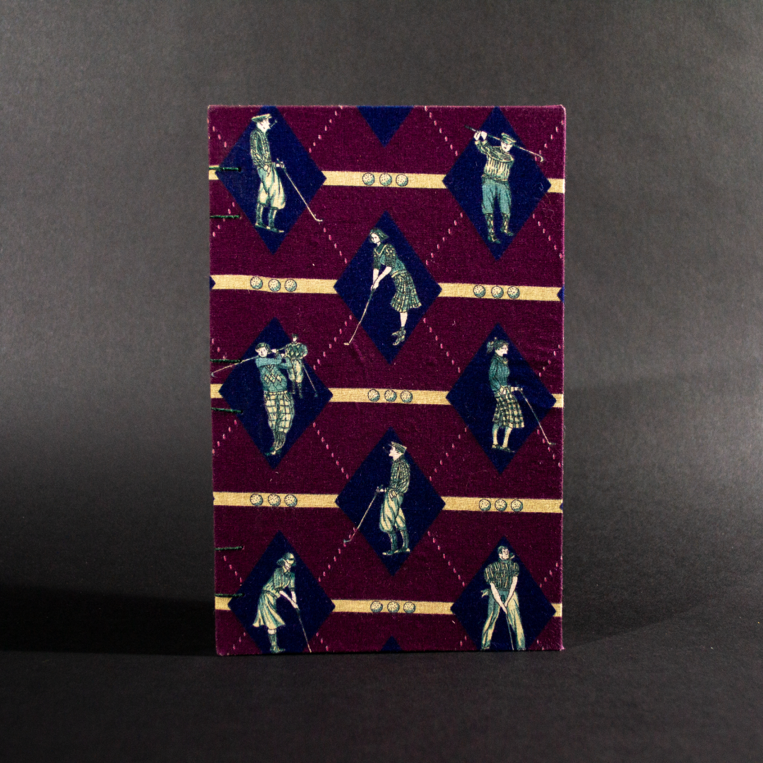 Front cover of retro golfers quarto Coptic bound journal with images of golfers on a burgundy background.