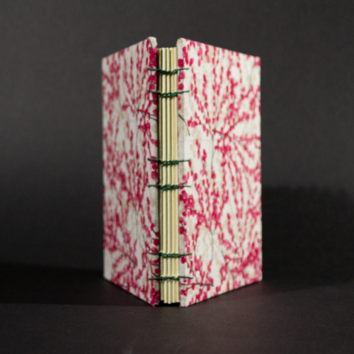 spine of cherry blossoms octavo Coptic book