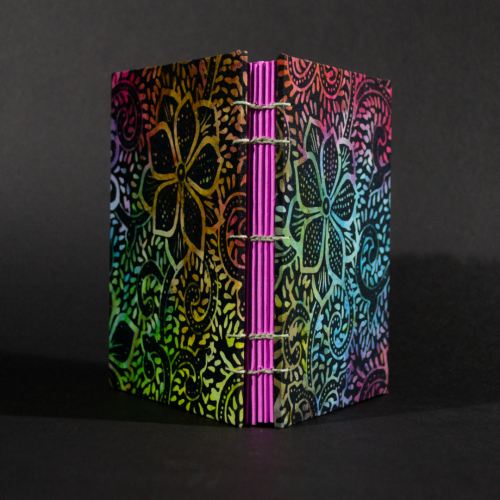 Spine view of rainbow batik flowers octavo Coptic book