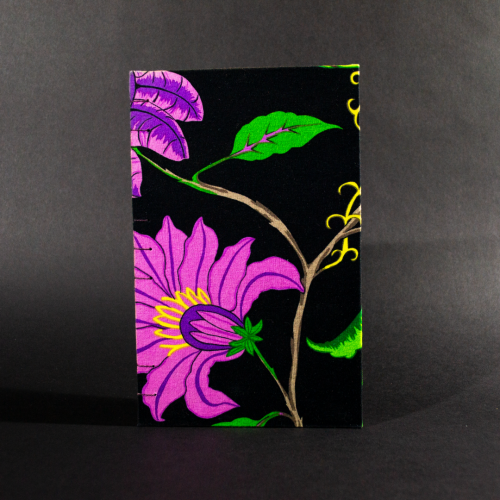 Black floral quarto Coptic bound journal front cover with large bright pink flowers on a black background