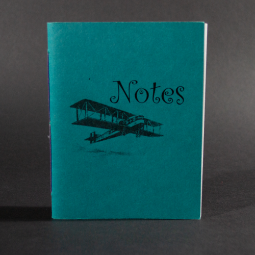 "A biplane and the word ""Notes"" is on the cover of this blue octavo pamphlet book"