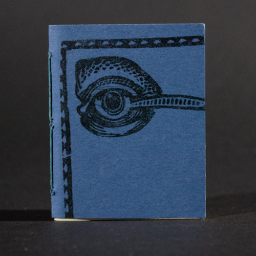 A blue eye graces the front cover of this mini pamphlet book