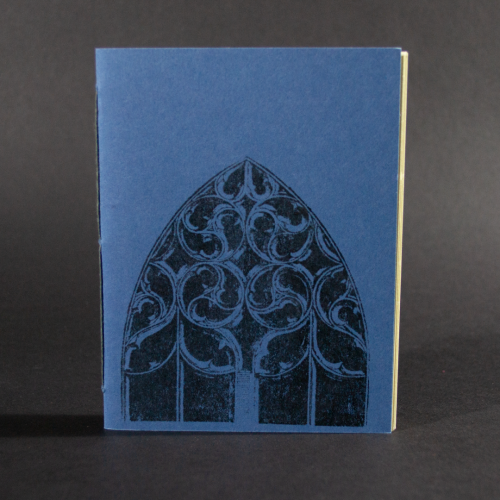 An arched window is on the cover of this blue octavo pamphlet book