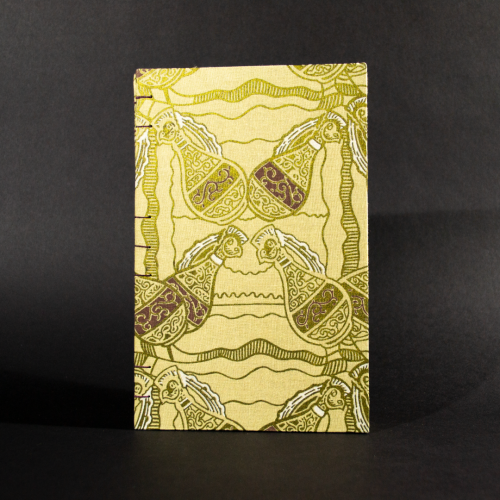 Front cover of four jugs lined quarto Coptic bound journal with gold jugs on an ivory background