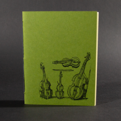 Four stringed instruments are on the cover of this green octavo pamphlet book