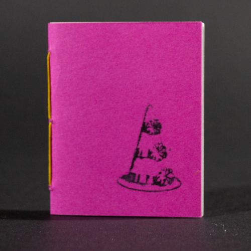 A pink clown hat is transferred on the front cover of this mini pamphlet book