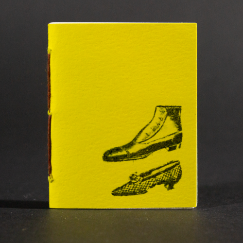 Two yellow shoes are on the cover of this mini pamphlet book