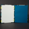 Insides of geometric blue and yellow octavo Coptic book with blue cardstock pages and white end pages